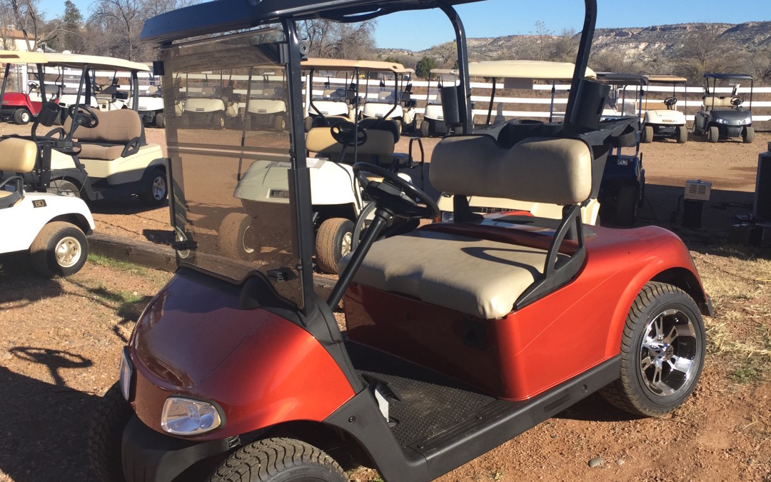2011 EZGO RXV Golf Cart – Texas Orange